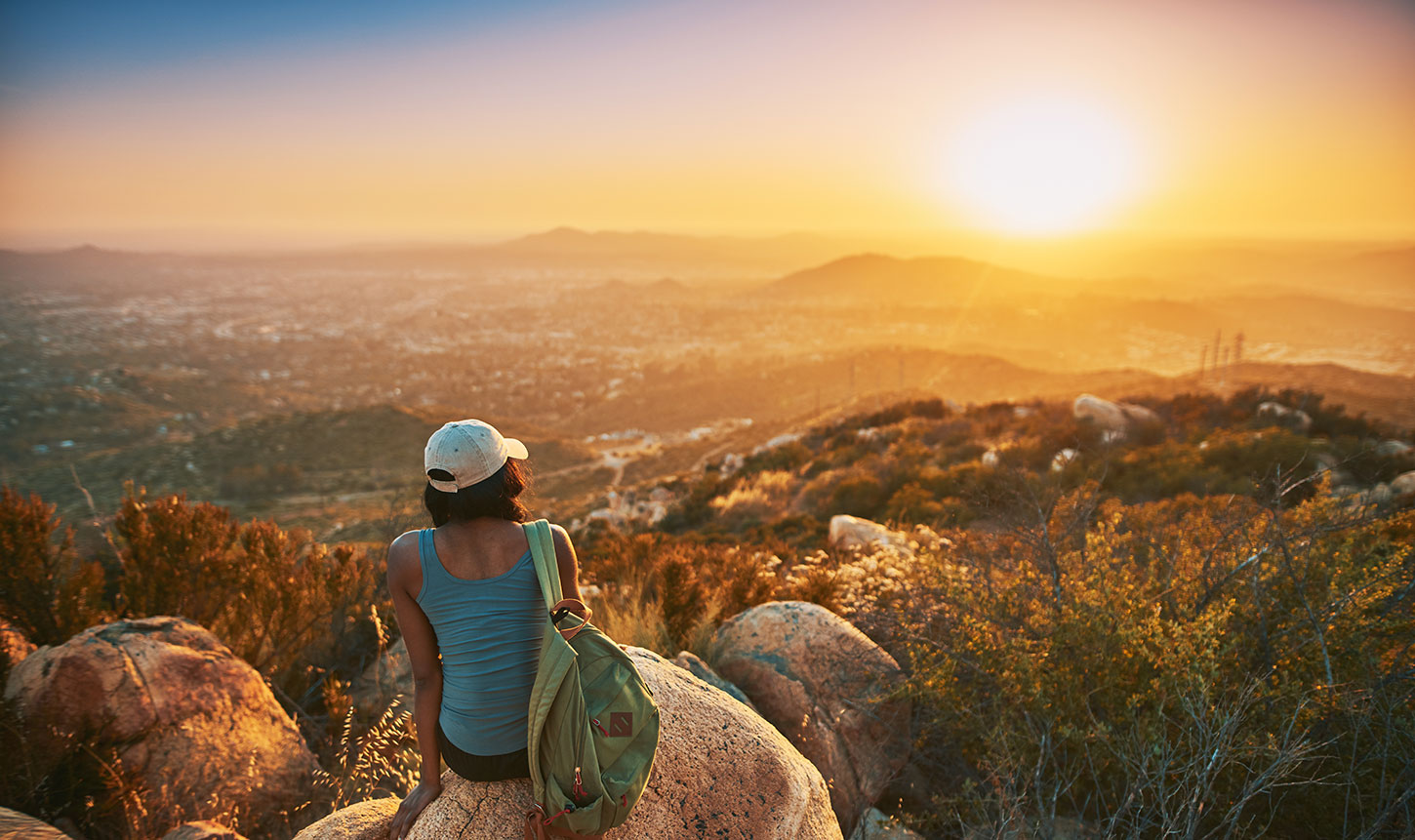 Hiker watching sunset from mountains