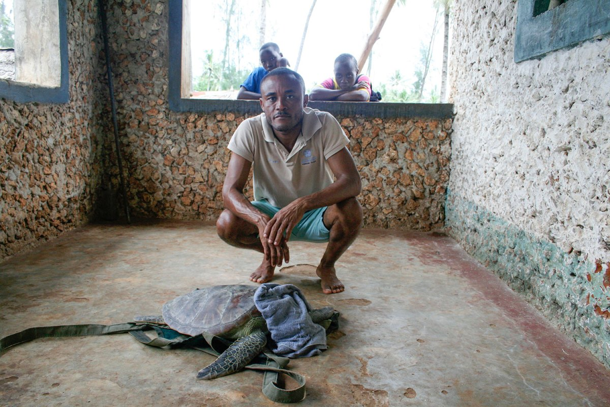 Fikiri Kiponda in hut with sea turtle bycatch. Photo by Amy Yee.