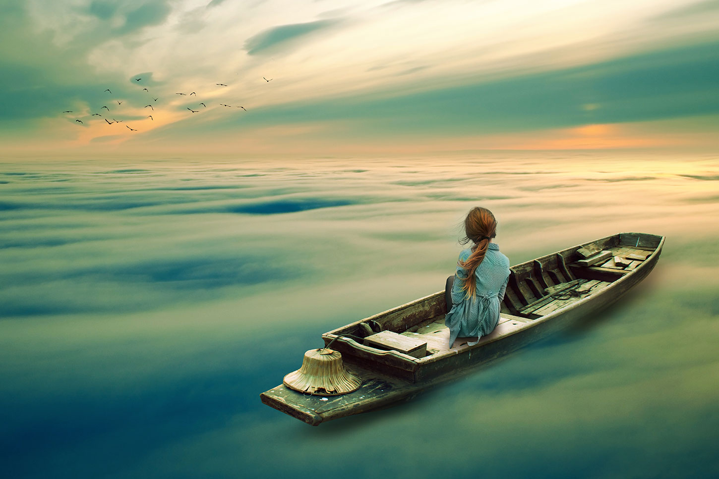 Woman in boat on ethereal sea