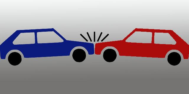 Choque frontal de dos vehículos.