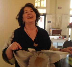 Patricia O'Neal modelling a silk scarf.