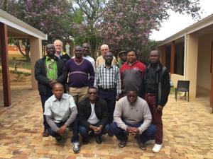 Cape Town Tertianship Group 2018-2019 Kneeling: Patric Razafimahafaly (MDG), Kevin Odey (ANW), Bboloka Nchimunya (ZAM). Middle Row: Jamesylvester Urama (ANW), Bernard Karerwa (RWB), Simon Nsielanga (ACE), Philmon Tirkey (HAZ), Cyrille Kazwala (ACE). Back Row: Mike Lewis (SAF), Gilbert Banda (ZIM), Jim McGloin (ZAM), Fidele Ingiyibere (RWB).