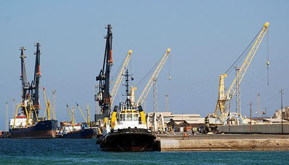 Modern tugboats.  Tower cranes at Massawa ports with a cabability of lifting up to 75 tones