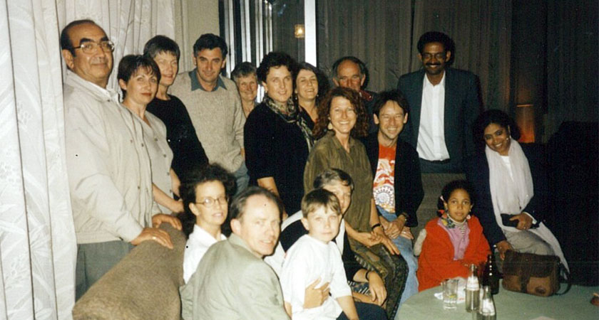 Fessehaie and family with a group of Australian aid volunteers in Eritrea in 1995.