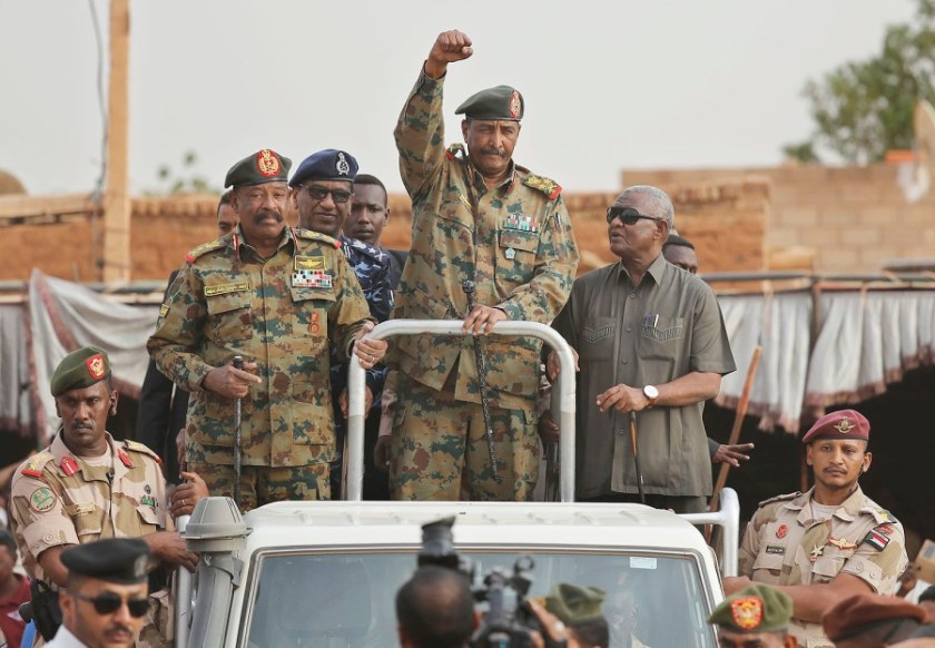 Sudan's top general has said the military council that assumed power in April will be dissolved with the implementation of a power-sharing deal.
