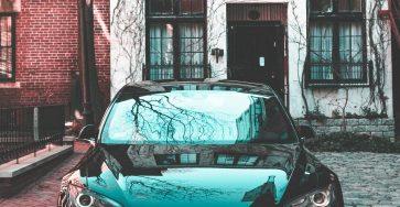 Black Tesla Model S pre facelift with Snow