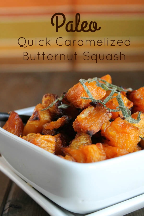 optimized for pinterest white bowl filled with golden and caramelized cubes of butternut squash with a ribbon of sage on top