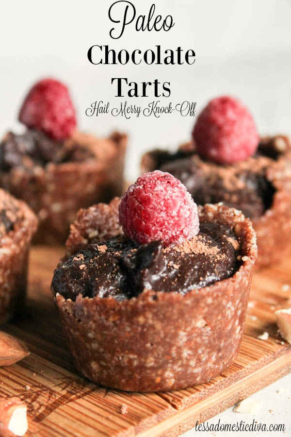 mini chocolate tarts topped with raspberries from eye level