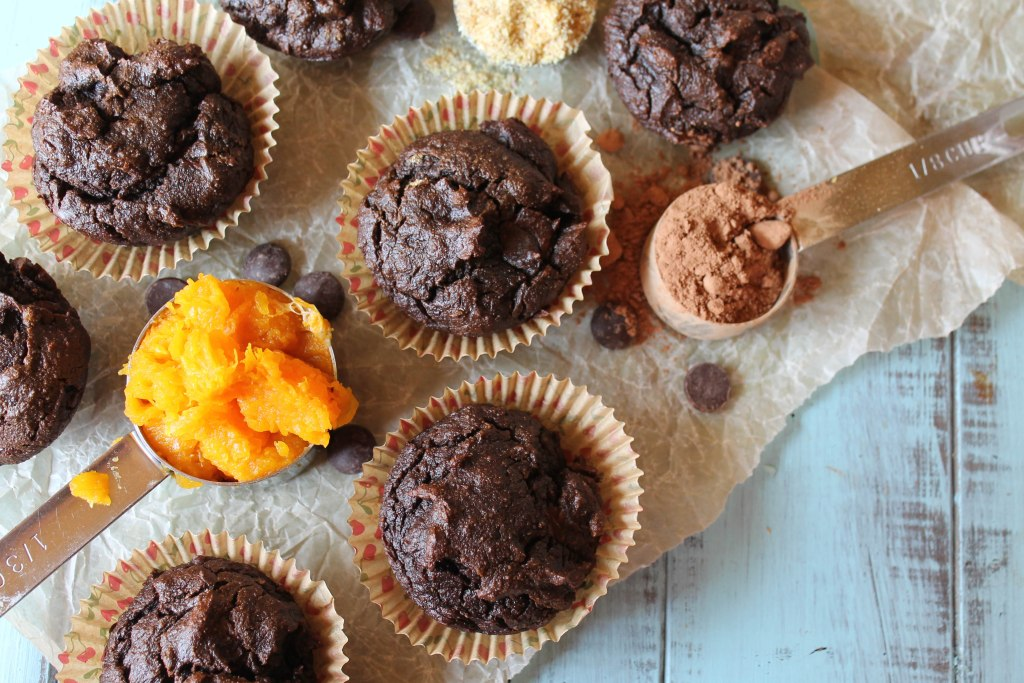 a collage of chococlate butternut muffins from above with a scoop of squash puree, cocoa powder, and almond flour placed around