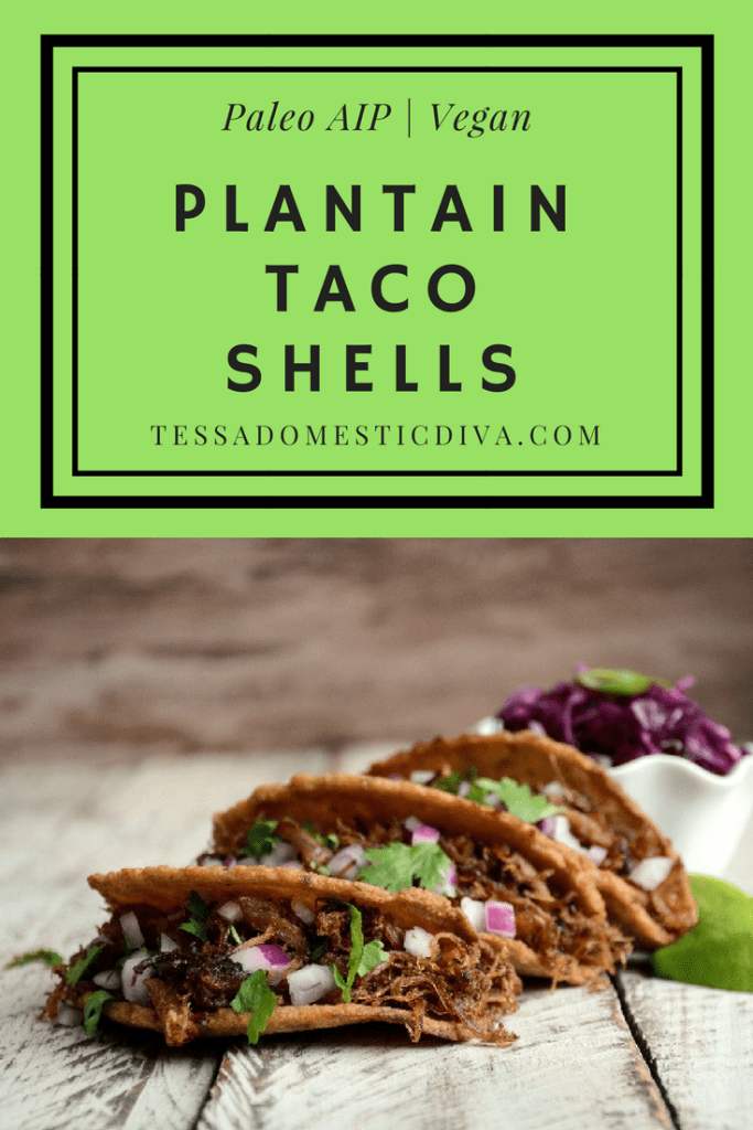 optimized for pinterest three crispy plantain taco shells filled with carnitas cilantro and purple cabbage arranged on a white-washed board.