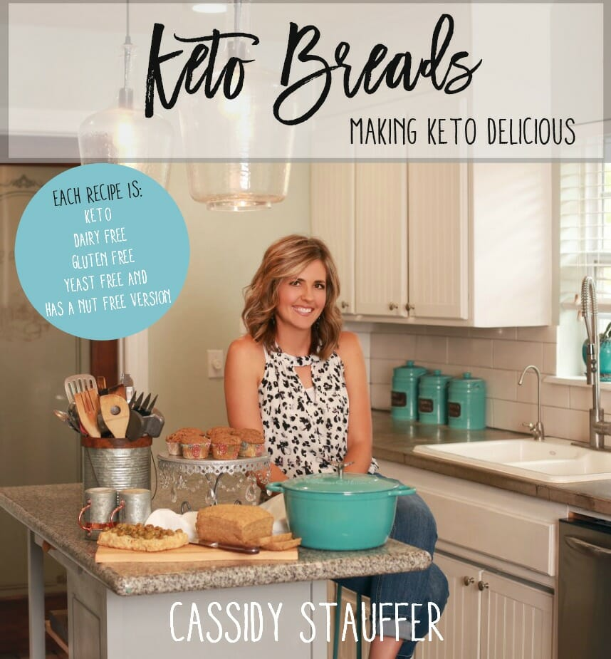 cookbook cover image for keto breads cookbook author standing in kitchen