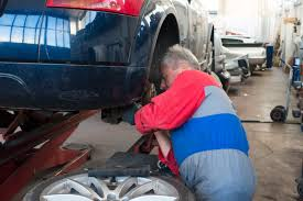 mechanic inspecting vehicle