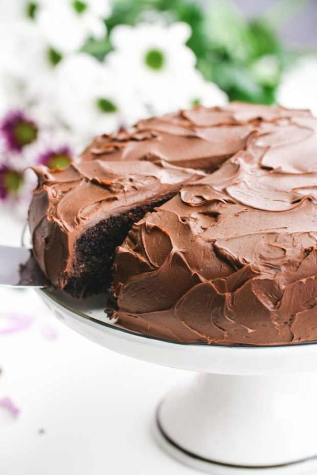 This delicious vegan chocolate cake is fudgy, super moist, chocolaty and is topped off with an easy whipped chocolate ganache frosting! Can be made gluten-free, whole wheat or with all-purpose flour. Tastes just like a regular chocolate cake!