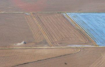 ...plowing near a flooded field...