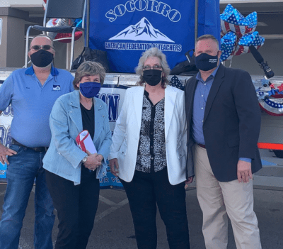 Ross Moore stands next to A-F-T President Randi Weingarten, Socorro A-F-T President Veronica Hernandez, and Texas A-F-T President Zeph Capo at an outdoor event. All are wearing face masks.