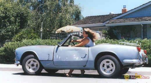 woman driving Flintstones car