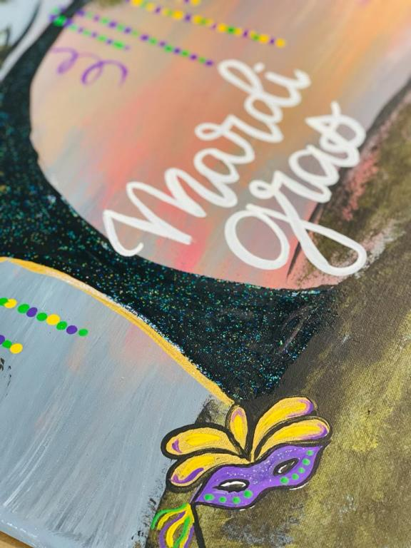 Mardi Gras mask and tree trunk painting with words Mardi Gras