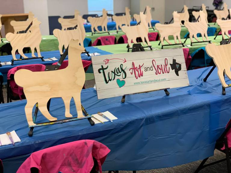 Cute llama wood cut outs set up for paint party