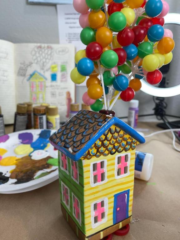 colorful hand painted ceramic house with balloons