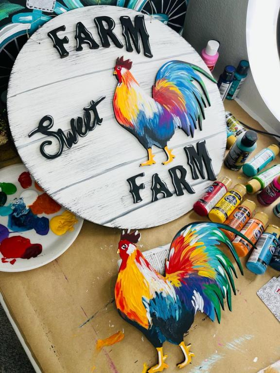 wood door hanger with words farm sweet farm and brightly painted rooster