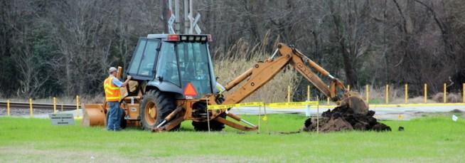Backhoe at damage site