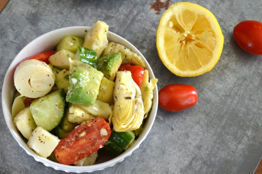 Marinated Artichoke Salad is crazy good combination of avocado, tomatoes, cucumbers, artichoke hearts and hearts of palm in a tangy, garlic dressing.