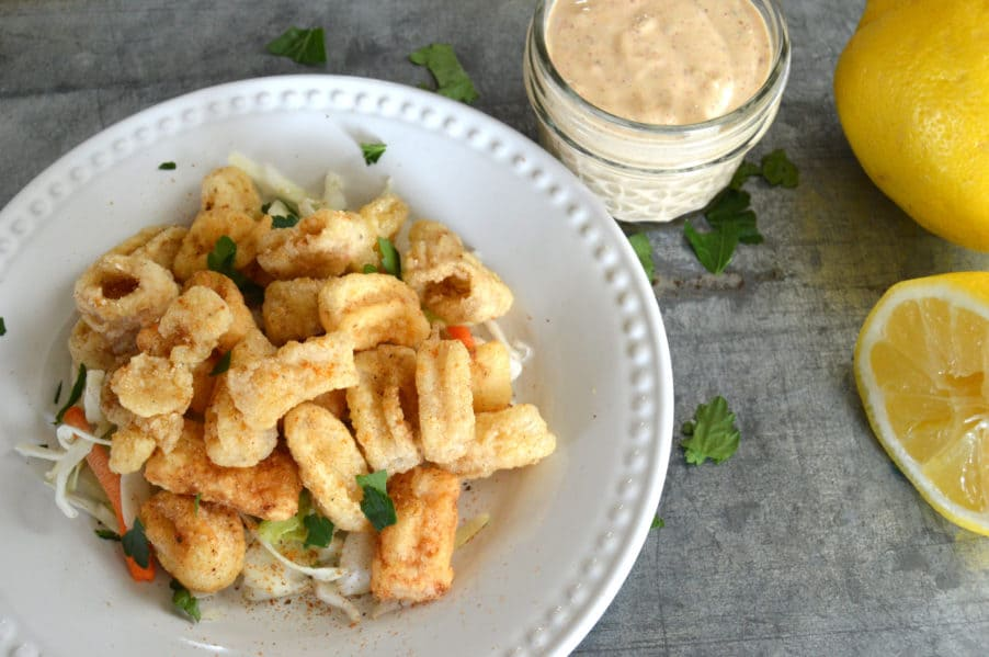 Perfectly crispy, gluten free golden fried calamari with dynamite dipping sauce