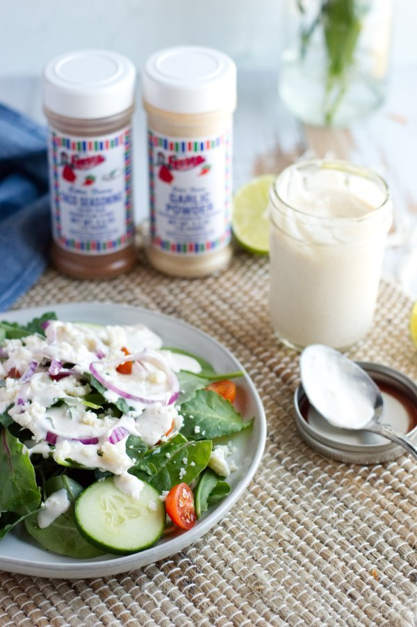 Salad with Keto salad dressing in jar and spices