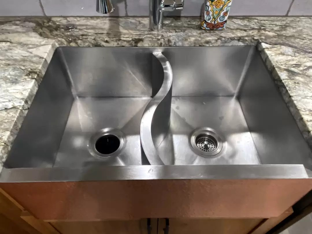 custom s sink with hammered apron