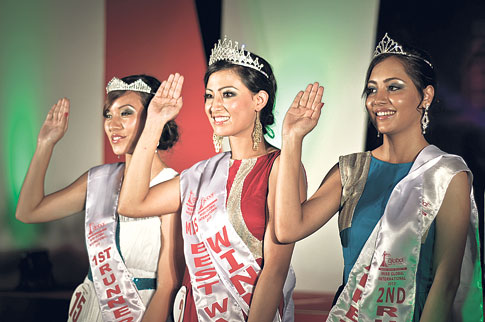 Photo Source: Republica/Winner Aastha Manandhar (C), 1st runner-up Urisha Joshi (L) and 2nd runner-up Sabrina Khadka pose for a picture after the announcement of winners during the Miss Global International 2013 at Army Officer´s Club, Kathmandu on Sunday.