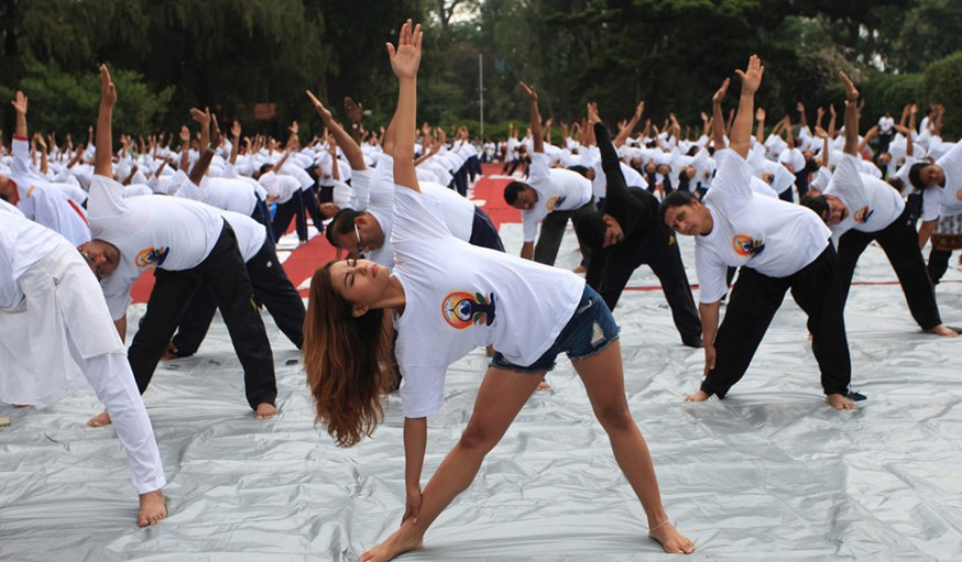 People practise yoga on the first International Yoga Day in Kathmandu, Nepal, June 21, 2015. (Xinhua/Sunil Sharma)