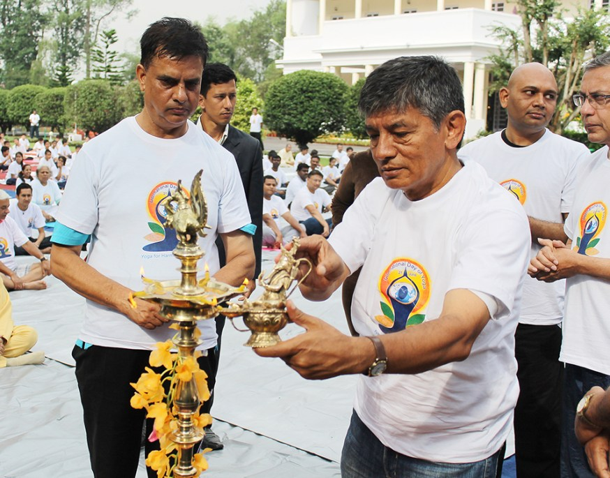 Comedian Madan Krishna Shrestha with Hari Bansha Acharya and Indian Ambassador to Nepal Ranjit Rae inaugurates the International Day of Yoga 2015 on Sunday at the premises of India Embassy, Lainchaur, Kathmandu. Photo: Kumar Shrestha/RSS