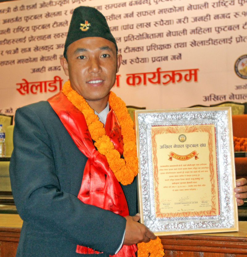 Raju Tamang poses for a photo with the certificate of the best Best Footballer Award of the Year, in Kathmandu, on Tuesday, May 31, 2016. Photo: Udipt Singh Chettry