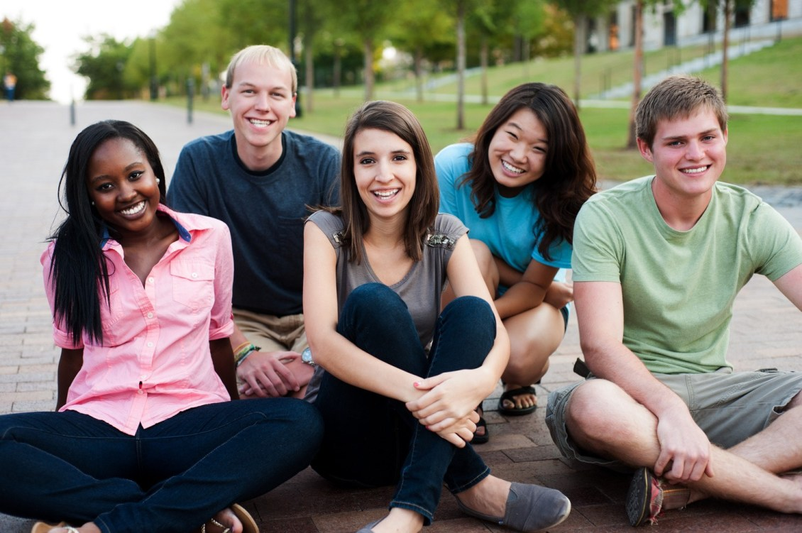 Diverse group of friends outside smiling together in special ed