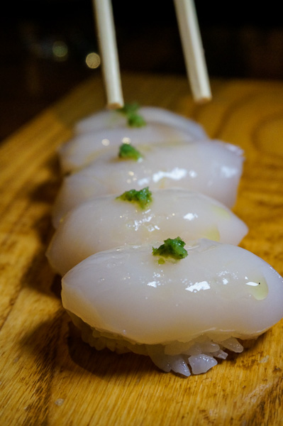 Namahotate, dayboat scallop nigiri, with a dot of yuzu kosho and a few flakes of Maldon salt.