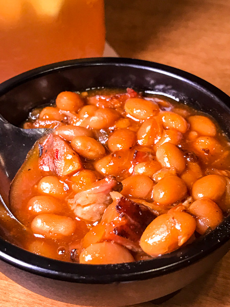 Wilbur beans with smoked brisket and sausage are a tinge sweet with some spice from jalapeños.