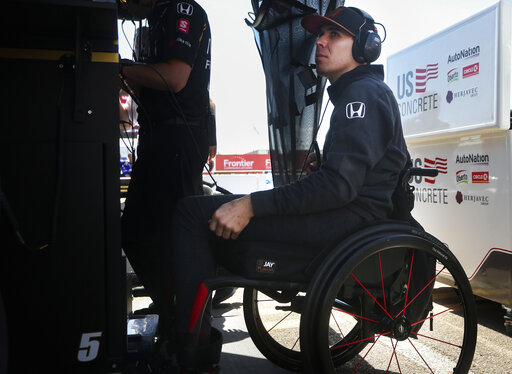 wickens uses hand controls to drive parade lap at toronto