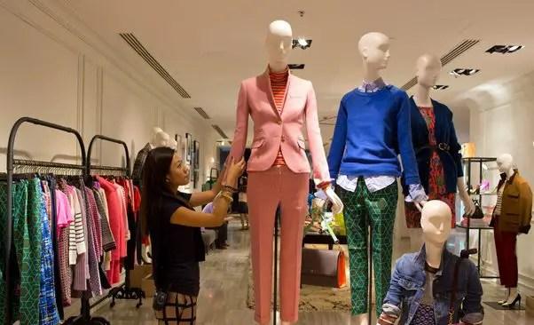Manikins in dress display in retail shop