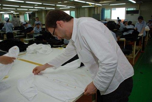 Final inspection of shirt