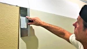 Fix walls with a skim coat