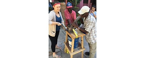 Haiti - Maureen trying Biomass Grinder