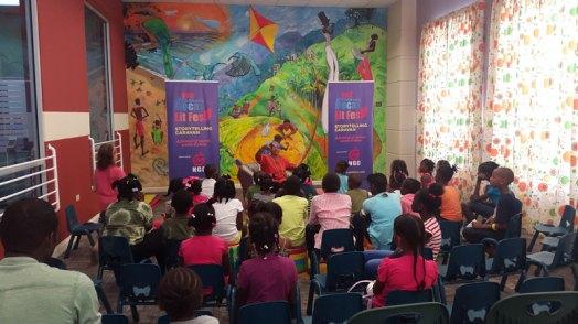 Thelma Perkins Displays a miniature lion to Children at Bocas Lit Storytelling Caravan Tobago.