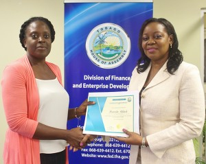 Administrator of the Division of Finance and Enterprise Development, Mrs. Claire Davidson-Williams presenting Ms. Morenike Adekale of the Division of Settlements and Labour with her certificate at the closing ceremony of the Public Private Partnership Workshop which was held the Victor E. Bruce Financial Complex on 24th March, 2016.