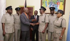 Chief Secretary Kelvin Charles, third from left, shakes hands with acting Assistant Commissioner Garfield Moore, head of the Tobago Division of the Trinidad and Tobago Police Service, following a meeting at the Office of the Chief Secretary on Monday (February 13, 2017). Also in photo are, from left, acting Superintendent Vernon Roberts, acting Superintendent Collis Hazel, THA Chief Administrator Raye Sandy, acting Superintendent Sterling Roberts and acting Senior Superintendent Joanne Archie.