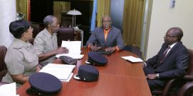 Chief Secretary Kelvin Charles, second from right, and THA Chief Administrator Raye Sandy, right, chat with acting Assistant Commissioner of Police Garfield Moore, second from left, and acting Senior Superintendent Joanne Archie during a meeting on the fight against crime at the Office of the Chief Secretary this morning (February 13, 2017).