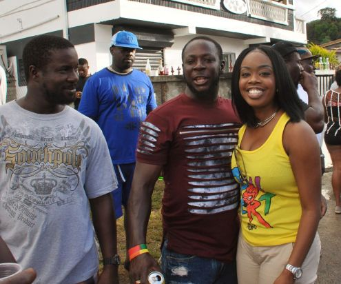 Secretary of Tourism, Culture, and Transportation Nadine Stewart-Phillips is all smiles, along with a few revellers, at Roxborough J'Ouvert.