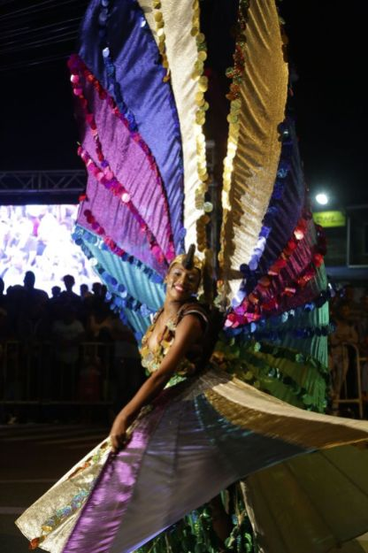 Winner of the Individual Female category for 'Flight of the Humming Bird', Oshun Mills sparkles with the colourful wings of her costume.