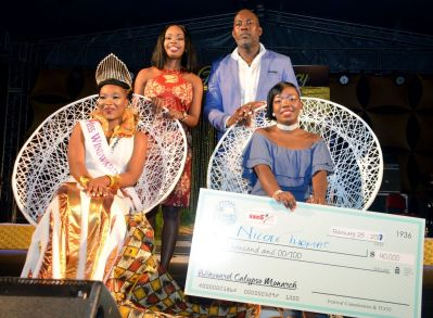 Back row, Secretary for the Division of Tourism, Culture, and Transportation Nadine Stewart-Phillips and Chairman of the Windward Carnival Development Committee, Julian Celestine ,pose with, front left, Windward Afro Queen winner Karisse Murray and Calypso Monarch winner, right, Nicole Thomas.
