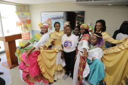 Young dancers surround veteran singer and Tobago icon Calypso Rose.