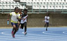 The start of Heat Two in the Girls U-9 4x100M event.